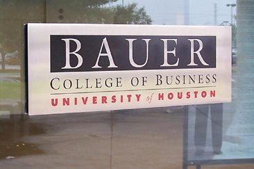 Bauer College of Business at the University of Houston sign on a window.